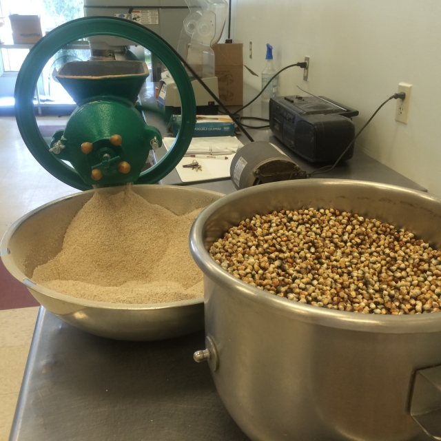 Blue corn kernels are toasted before being ground into flour for atole, a traditional blue corn porridge.